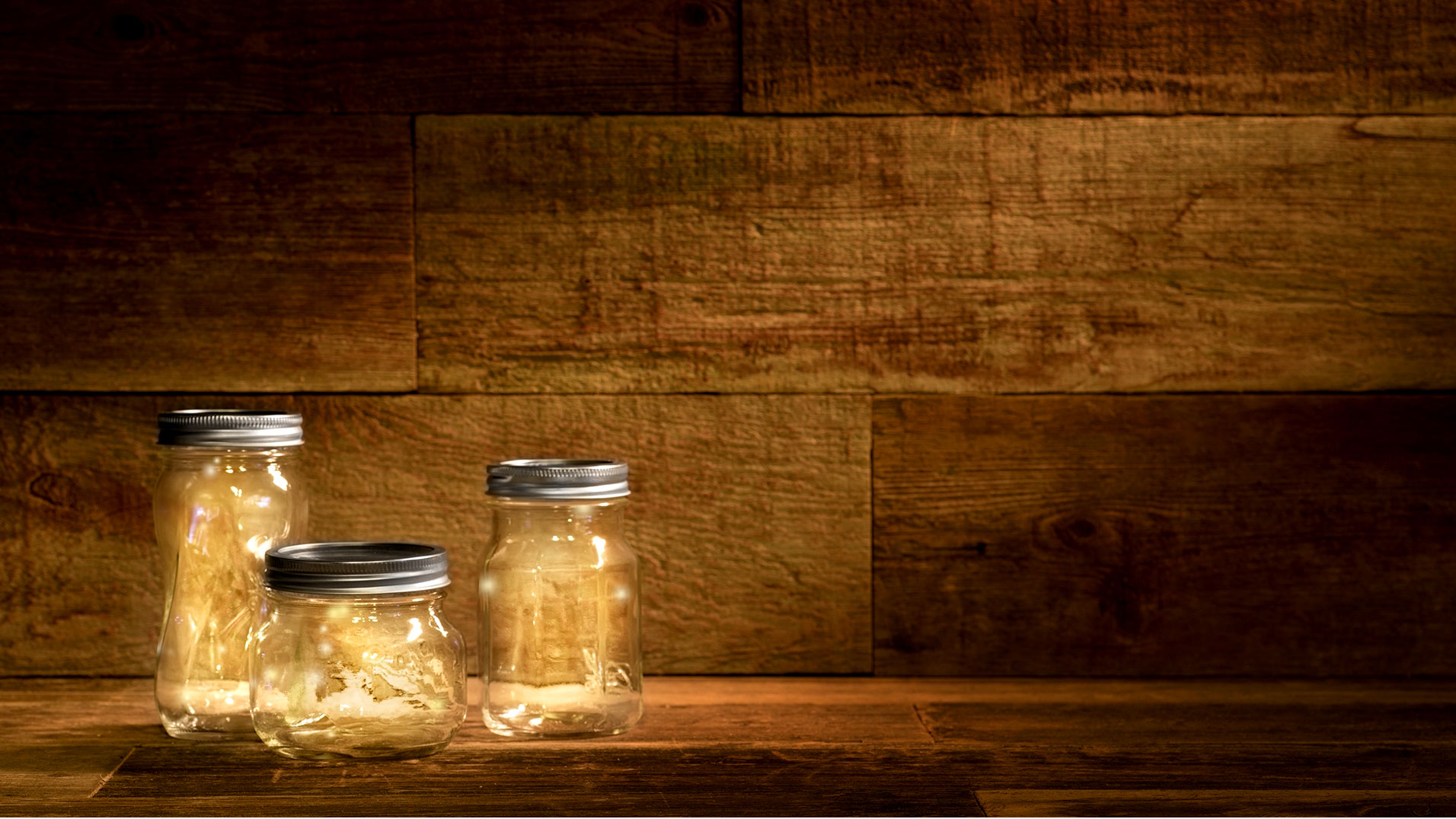Fireflies And Jars On A Wood Pallet Background