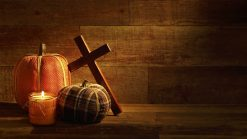 This is a Thanksgiving fall video with a pumpkin and wooden cross